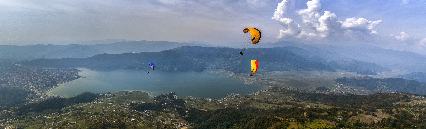 Flying over the Phewa lake paragliding in pokhara Nepal
